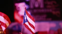 Two Puerto Rican Flags being held at Festival Stock Footage