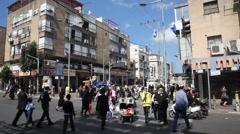 People walk in the streets of Bnei Brak Stock Footage