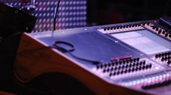 Audio Mixing Console with Audio Engineer in front during Show Stock Footage
