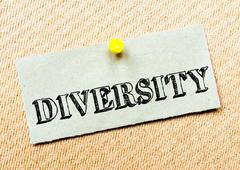 Recycled paper note pinned on cork board. Diversity Message. Concept Image - stock photo
