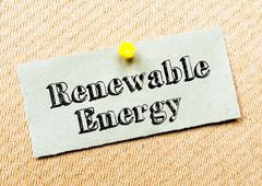 Stock Photo of Recycled paper note pinned on cork board. Renewable Energy Message