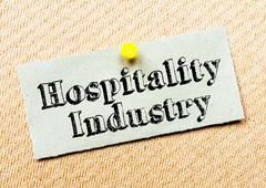 Recycled paper note pinned on cork board. Hospitality Industry Message - stock photo