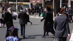 People walk and have fun in the main street during Purim Stock Footage