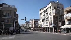 Establishing shot of Rabbi Akiva street, the main Street of the city - stock footage