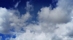 Time-lapse White Puffy Clouds with Clear Blue Sky - stock footage
