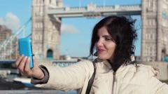 Selfie in london: tourist woman making photos near London bridge Stock Footage