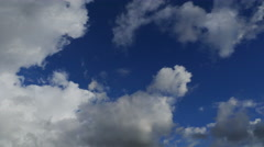 Time-lapse White Puffy Clouds with Clear Blue Sky (UltraHD 4K) - stock footage