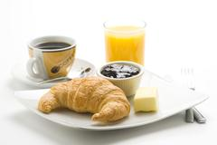 delicious continental breakfast of coffee and croissants - stock photo