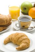 Delicious continental breakfast of coffee and croissants Stock Photos