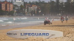 Lifeguard in Sydney gets off Quad bike Stock Footage