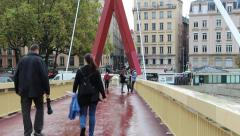 People passing through the bridge over the river Saone. Lyon France Stock Footage