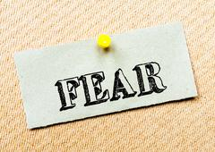Recycled paper note pinned on cork board. Fear Message. Concept Image Stock Photos