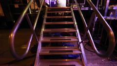 Subjective shot of someone entering a music stage through Stairway Stock Footage