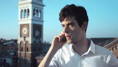 Anxious young man at the mobile phone: nobody answers to his call Stock Footage