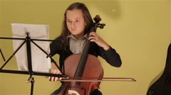Young Girl Playing Violoncello Looking At The Notes Cellist Soloist Stock Footage