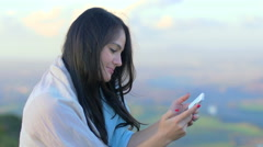 Beautiful woman using smartphone outdoor in a countryside landscape Stock Footage
