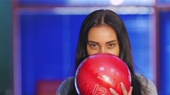 Beautiful brunette with red ball enjoys scored a strike Stock Footage