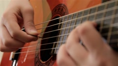 Playing Acoustic Guitar Side Angle Close Up, Strumming, Right Hand In Focus Stock Footage