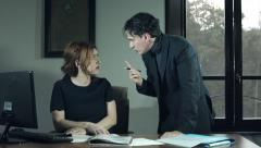 Quarrel in office: angry boss and employee having a bad discussion Stock Footage