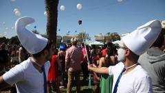 Costumed young and happy revelers take selfie during Purim Rave - stock footage