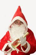 Santa with Champaigne - stock photo