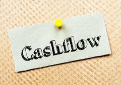 Recycled paper note pinned on cork board. Cashflow Message. Concept Image Stock Photos
