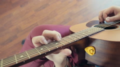 Man playing acoustic guitar closeup slow motion Stock Footage