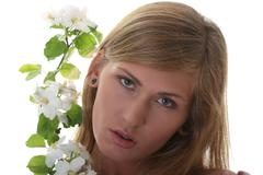 Beautiful blond woman with small white apple tree flowers Stock Photos
