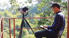 Wildlife photographer using tablet computer Stock Footage