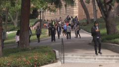 Diverse college students walking up and down stairs - stock footage