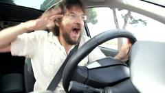 Man having fun in car dancing while driving - stock footage