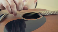 man playing acoustic guitar closeup slow motion - stock footage