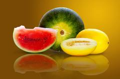 Beautiful isolated watermelon and yellow melon on yellow background Stock Photos