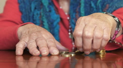 Stock Video Footage of poor old woman counts her little money remaining