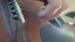 man playing acoustic guitar closeup strings slow motion - stock footage