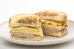 tasty sandwich of ham and cheese omelet - stock photo