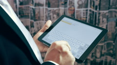 businessman composing text message on tablet computer - stock footage