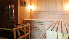 Empty sauna room without people camera moves from the heater to the door Stock Footage
