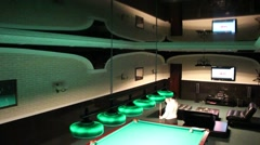 Woman  with the cue  billiards / pool Stock Footage