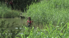 Police divers searching a river as part of a training exercise - EDITORIAL Stock Footage