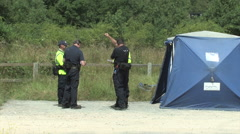 Police officers gather at an outdoor location for training exercise - EDITORIAL Stock Footage