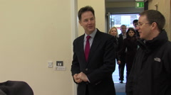 Politician Nick Clegg visits a British town to meet constituents and sign a deal Stock Footage