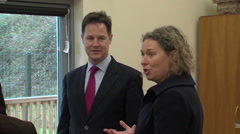 Politician Nick Clegg visits a British town to meet constituents and sign a deal - stock footage