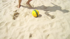 Man dribbles a soccer ball past defenders on sand. Stock Footage