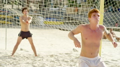 Friends practice soccer skills on a  beach in Brazil - stock footage