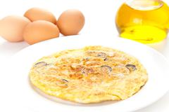 mushrooms olives and potatoes omelette - stock photo