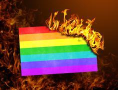 Flag burning - Rainbow flag Stock Photos
