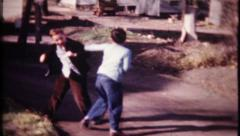 1857 - brothers fighting, boys boxing, fist fight - vintage film home movie Stock Footage