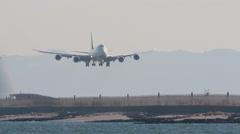 Airplane landing at Haneda airport in Tokyo, Japan Stock Footage