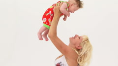 Young Mother Holding Her Son Aloft - stock footage